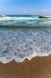 Foamy water on beach Stock Photos