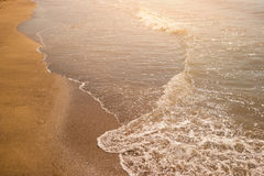 Foamy water on a shore. Royalty Free Stock Images
