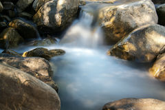 Foamy waters of a creek. Long exposure of water running down a tributary of the Putah Creek in Winters, California, USA, after the particularly stormy winter of Royalty Free Stock Photography
