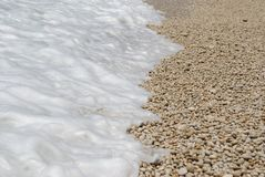 Foamy wave on the beach Royalty Free Stock Photography