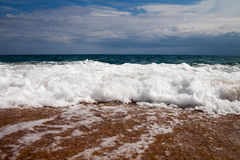 Foamy wave. Stock Photography