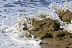 Foamy Waves Crash Onto Rock Royalty Free Stock Images