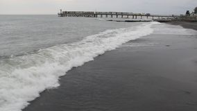 Storm on the Black sea. Foamy waves rolling on a deserted shore stock footage