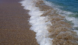 Foamy waves on the seashore Royalty Free Stock Photo
