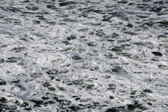 Foamy white ocean water Royalty Free Stock Images