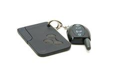Fob di tasto dell'allarme dell'automobile e un chip-card. Fotografia Stock Libera da Diritti