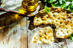 Focaccia bread with fresh basil Royalty Free Stock Photos