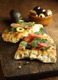 Focaccia bread with ham, rocket and olives Royalty Free Stock Photography