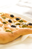 Focaccia Bread with Olives & Thyme. Focaccia bread is perfect for any occasion! This tender focaccia is topped with black & green olives, seasoned with thyme and Stock Images