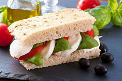 Focaccia with caprese. And fresh basil Stock Photo