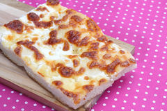 Focaccia with cheese on pink tablecloth Stock Photo