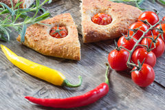 Focaccia with cherry tomatoes, fresh rosemary, peperone, selective focus Royalty Free Stock Images