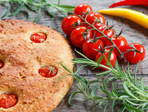 Focaccia with cherry tomatoes, fresh rosemary, peperone, selective focus Stock Images