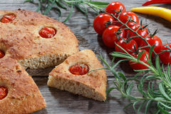 Focaccia with cherry tomatoes,  peperone, selective focus Stock Photo