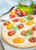 Focaccia with cherry tomatoes Stock Images