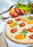 Focaccia with cherry tomatoes Royalty Free Stock Image