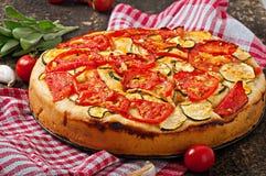 Focaccia con los tomates y el ajo Imágenes de archivo libres de regalías