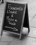 Focaccia e Pizza. A blackboard with the daily menu in Turin Stock Photos
