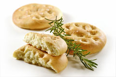 Focaccia flat bread with rosemary _1. Typical Italian focaccia with rosemary on white background Stock Photography