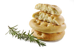 Focaccia flat bread with rosemary _5. Typical Italian focaccia with rosemary on white background Royalty Free Stock Photos