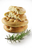Focaccia flat bread with rosemary_6. Typical Italian focaccia with rosemary on white background Stock Image