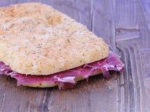 Focaccia with ham Iberian. Stock Photo