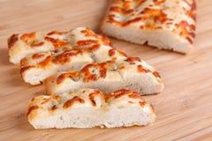 Focaccia. Italian bread on a cutting board Stock Photos
