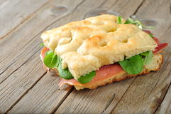 Focaccia with jam and rucola on a wodden board Stock Images