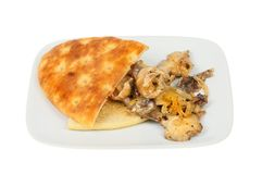 Focaccia and mushrooms. Shitake mushrooms and focaccia on a plate isolated against white royalty free stock images
