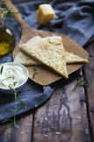 Focaccia with olive oil, parmesan cheese, white sause and rosema Royalty Free Stock Image