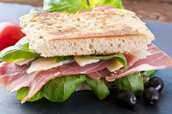 Focaccia with prosciutto Stock Images