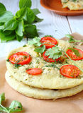 Focaccia with red tomatoes Royalty Free Stock Photo