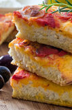 Focaccia with tomato and black olives. Stock Photography