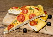 Focaccia with tomato  and black olives Royalty Free Stock Photo