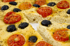 Focaccia with tomato  and black olives Stock Image