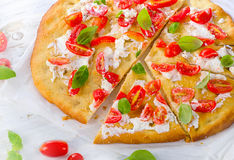 Focaccia with tomatoes, cream cheese and herbs Stock Photos