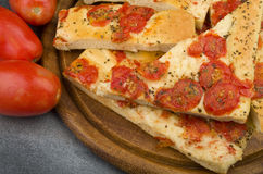 Focaccia with tomatoes Stock Photography