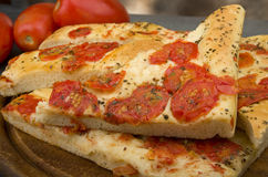 Focaccia with tomatoes Royalty Free Stock Photos