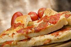 Focaccia with tomatoes Stock Photos