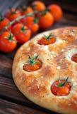Focaccia z czereśniowymi pomidorami Fotografia Royalty Free