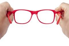 Focalizzazione rossa degli occhiali delle mani isolata Fotografia Stock Libera da Diritti
