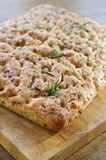 Foccacia Bread. Home baked italian foccacia bread with some fresh herbs on top Royalty Free Stock Photo