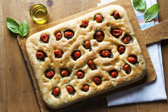 Foccacia on wooden table. Healthy food Royalty Free Stock Photography
