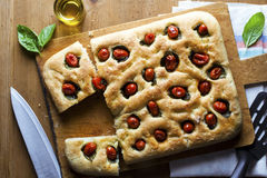 Foccacia on wooden table. Healthy food Royalty Free Stock Photo