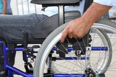 Foco en el sillón de ruedas Imagen de archivo