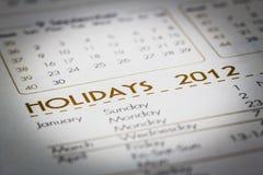 Foco a la palabra del día de fiesta en un calendario. fotos de archivo libres de regalías
