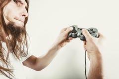 Foco masculino do jogador em jogos do jogo Fotos de Stock