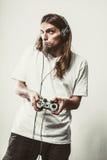 Foco masculino do jogador em jogos do jogo Foto de Stock