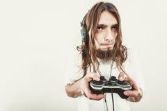 Foco masculino do jogador em jogos do jogo Imagens de Stock