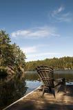 Foco na cadeira da casa de campo Fotografia de Stock